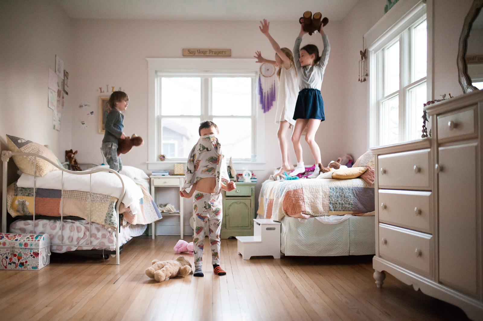 pic of kids jumping on a bed and getting dressed by Erin Konrath