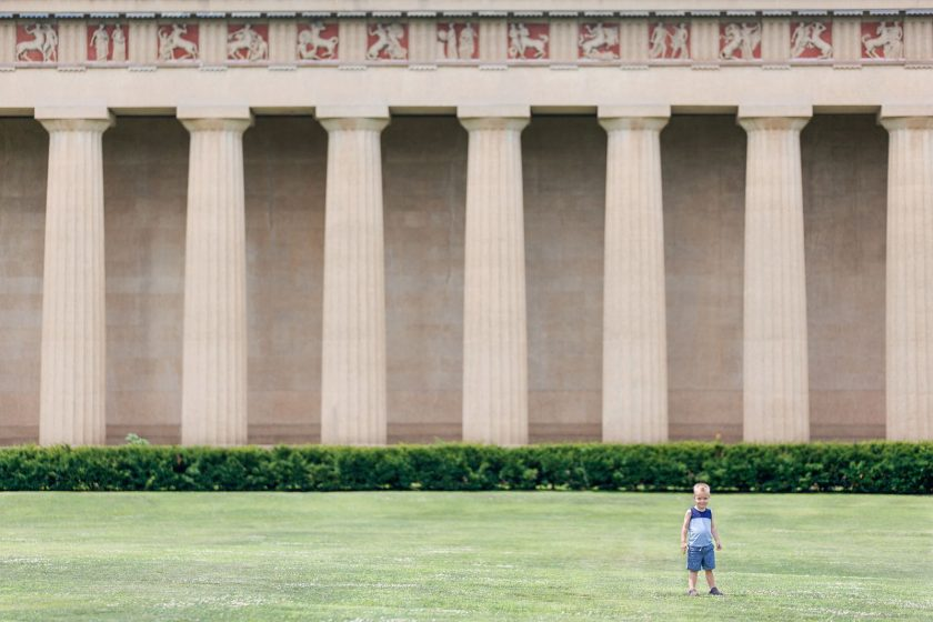 boy playing in front of the Parthenon by Leanne Vice