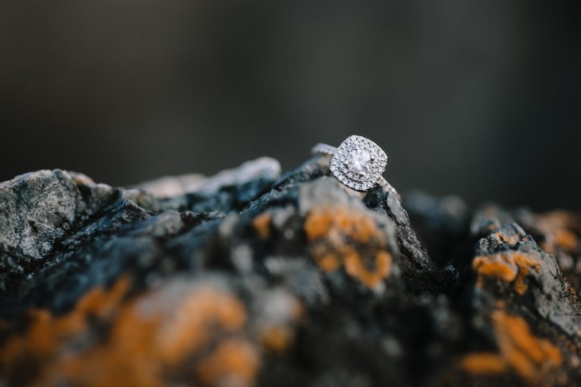 engagement ring on a rock by Ebony Logins