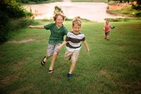photo brothers running in a field by Kimberly Milano
