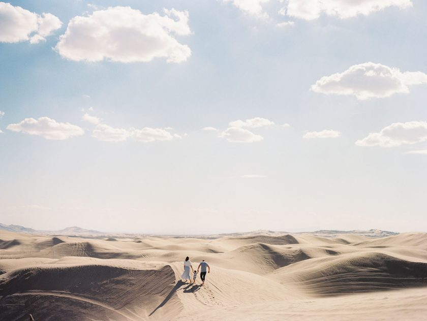 picture of family walking along sand dunes by Noelle Reynolds