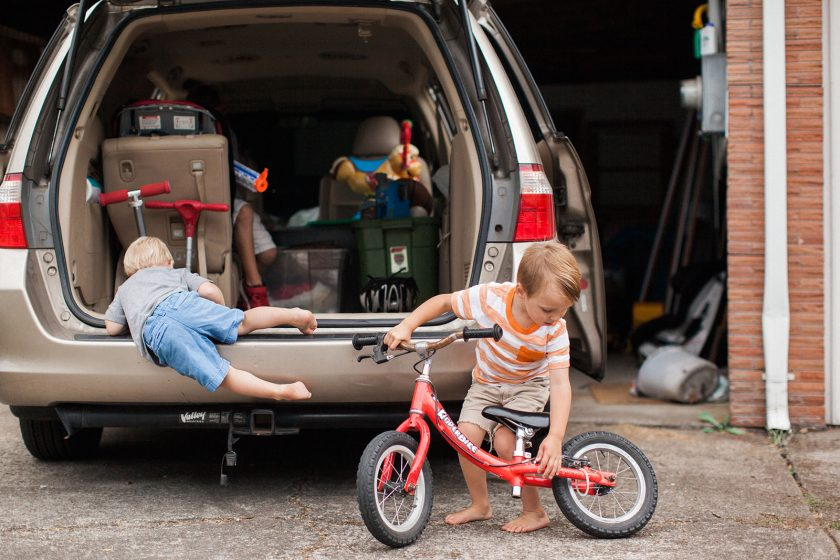 picture of kids putting bike in the back of a van by Lacey Monroe