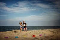 picture of two kids flying a kite on the beach by Rebecca Wyatt