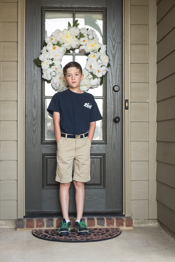 Pro-Photography-Tip-for-Back-to-School-Photos-Have-Child-Stand-in-Doorway-by-Megan-Cieloha