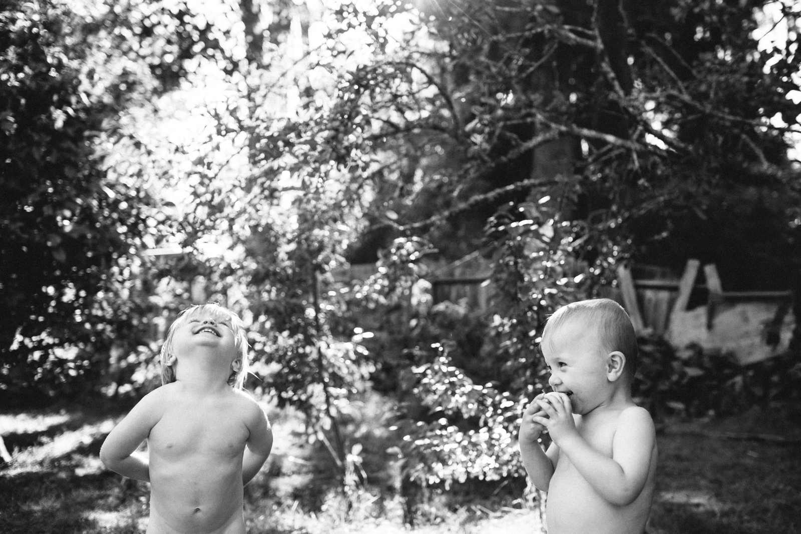 black and white pic of two boys outdoors by Meghan McMackin