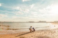 pic of two kids on a beach playing by Annick Paradis