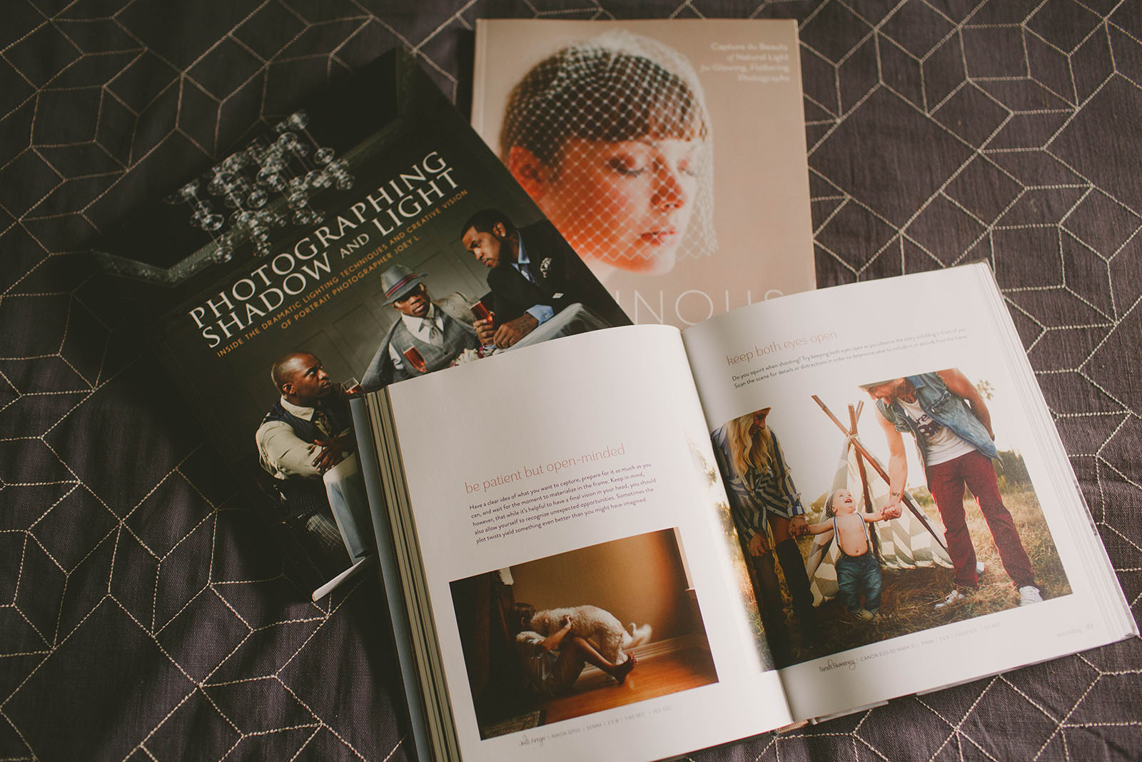 picture of photography books on a bed by April Nienhuis