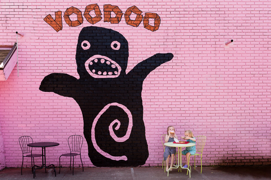 captivating-visual-tension-between-striking-pink-graphic-background-wall-and-children-eating-at-table-by-rebecca-hunnicutt-farren