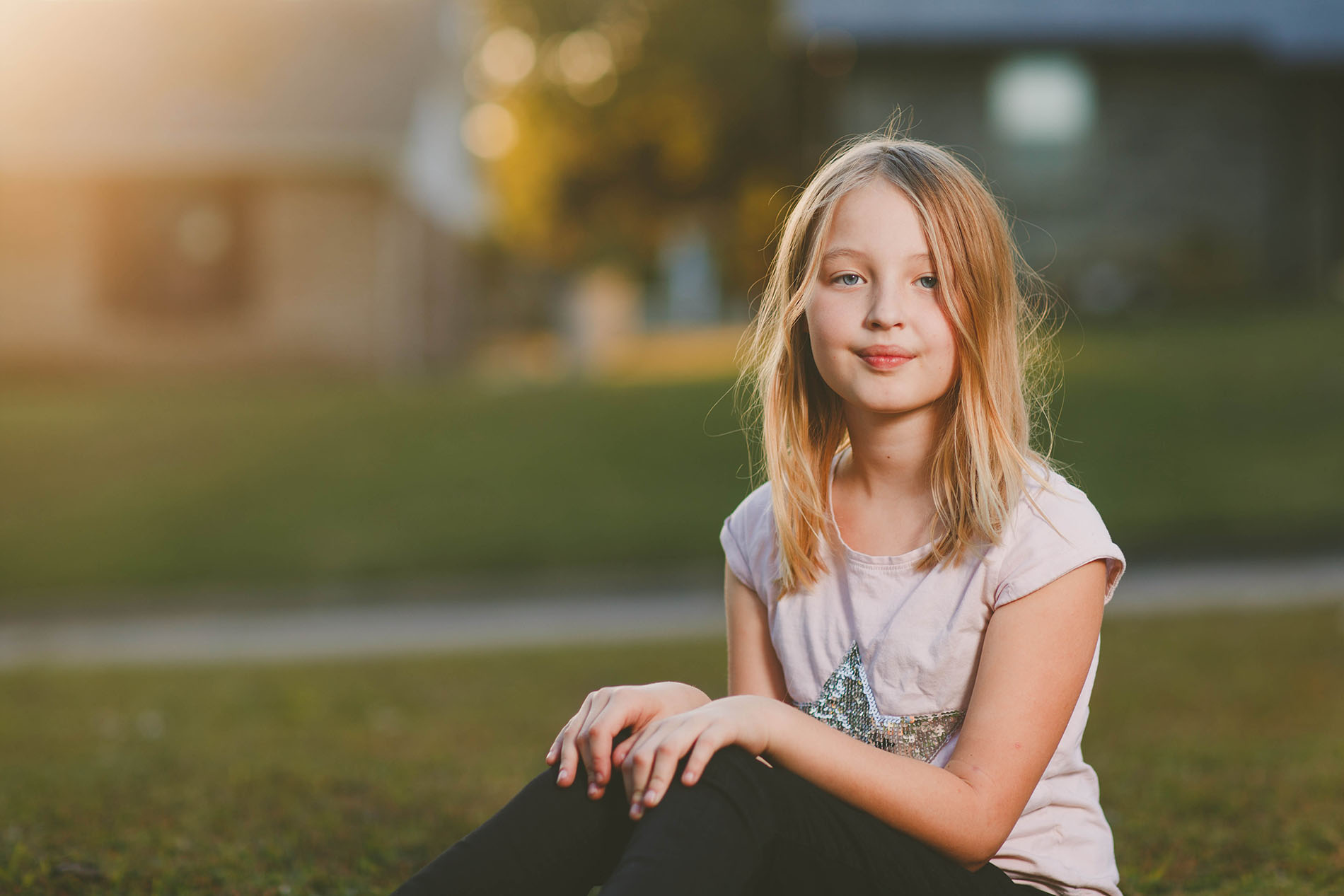 backlit photo of girl outdoors with the Profoto B1 off camera flash by April Nienhuis