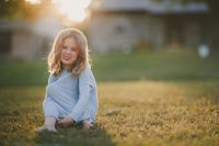 backlit photo of girl smiling by April Nienhuis