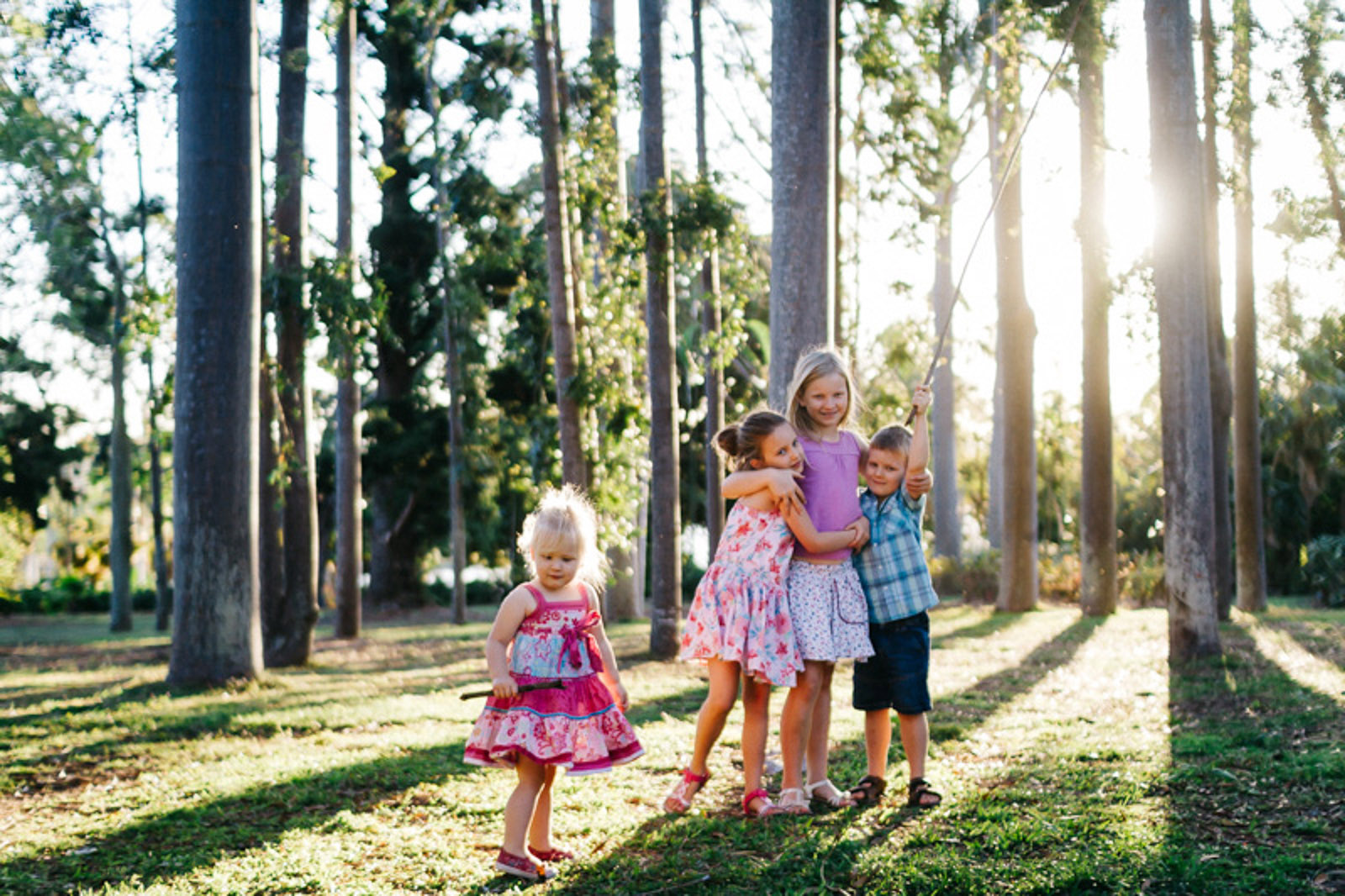 backlit-picture-of-kids-playing-in-the-trees-by-jayne-cho