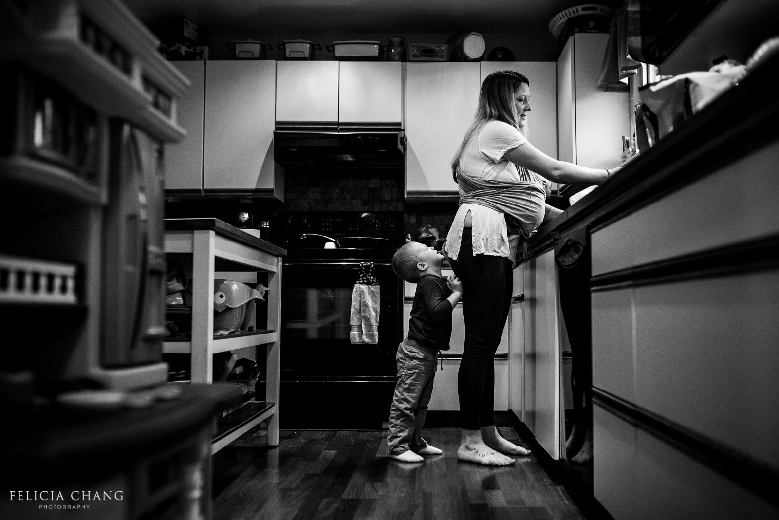 black and white photo of mom doing dishes by Felicia Chang