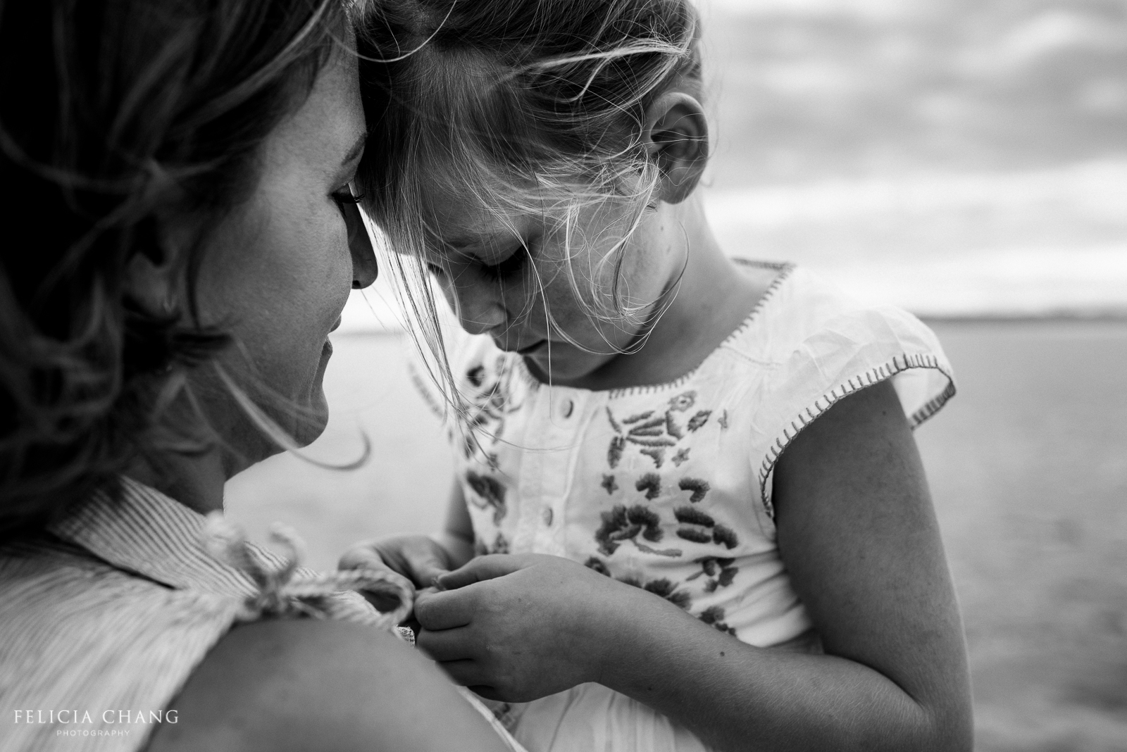 black and white portrait of mom and daughter by Felicia Chang