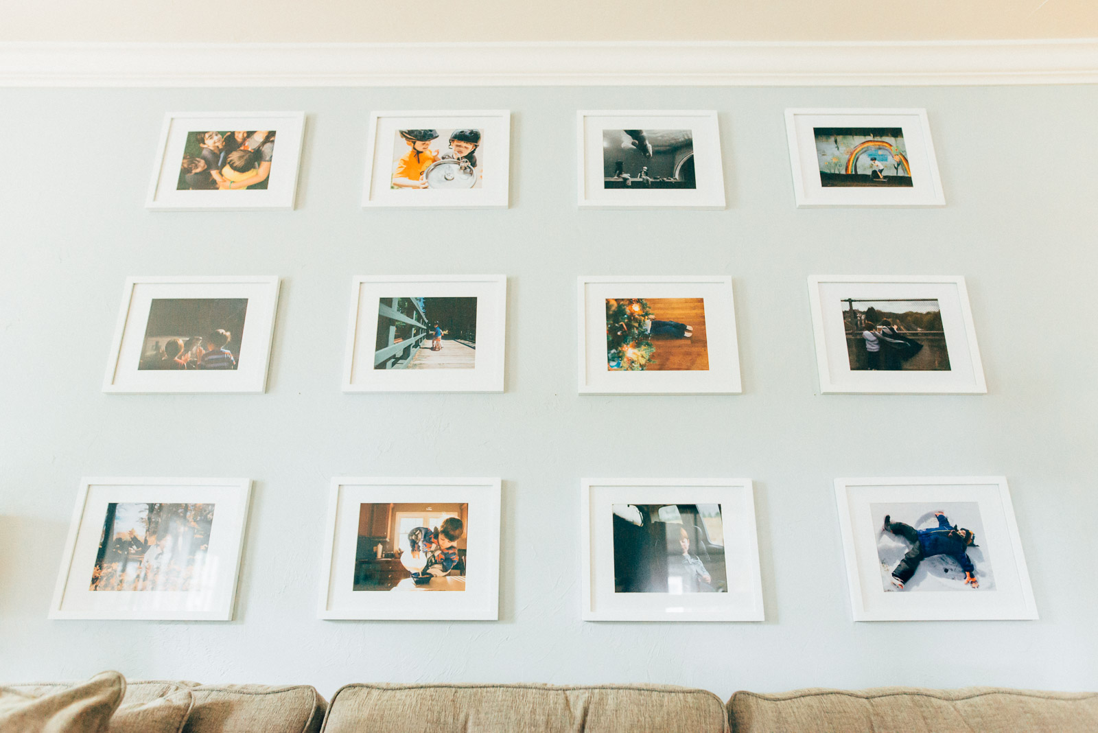 framed gallery wall in living room by Andrea Moffatt