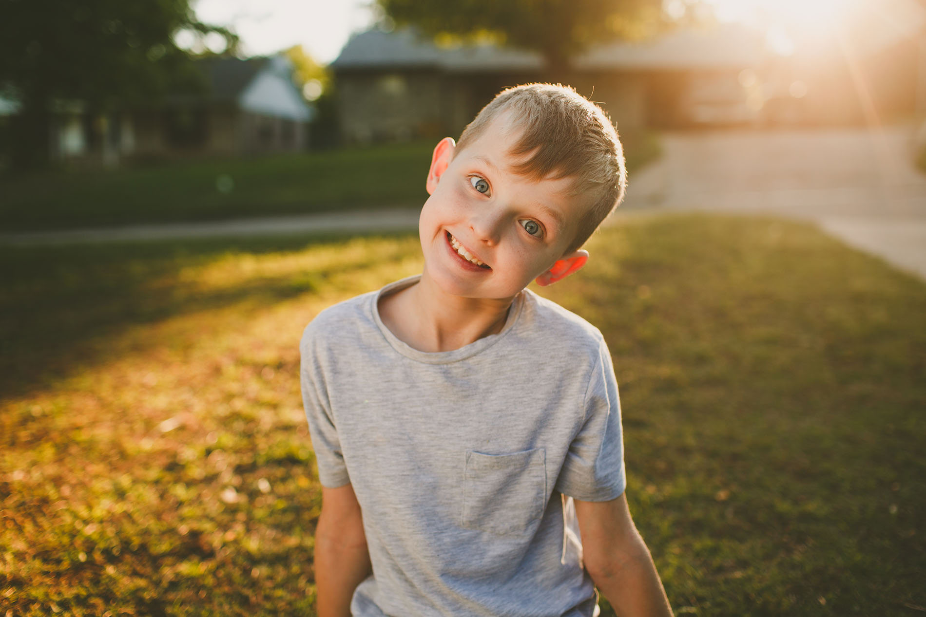 photo of boy smiling with a reflector by April Nienhuis