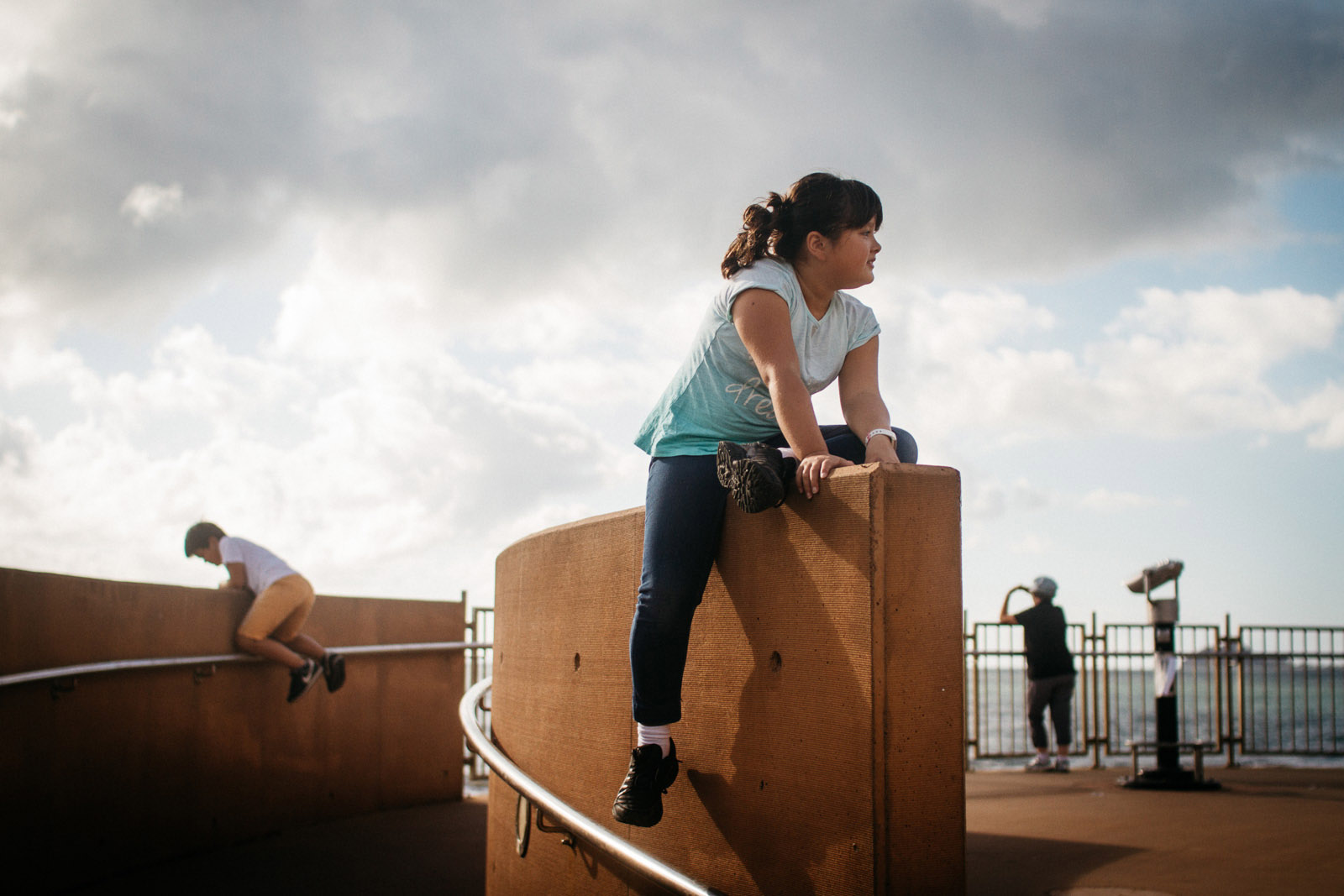photo of kids playing on an observatory by Jayne Cho