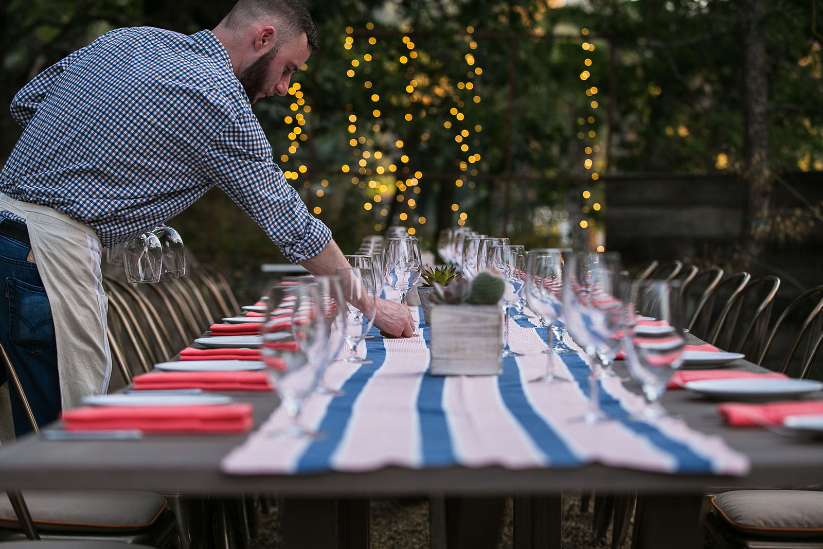 photo-of-man-setting-a-table-by-kristin-dokoza