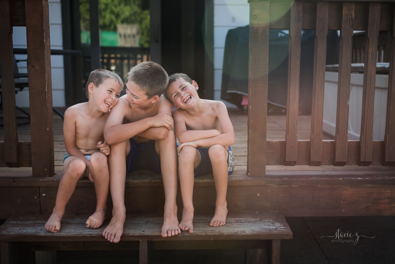 photo-of-three-brothers-sitting-and-laughing-by-stacie-zimmerman