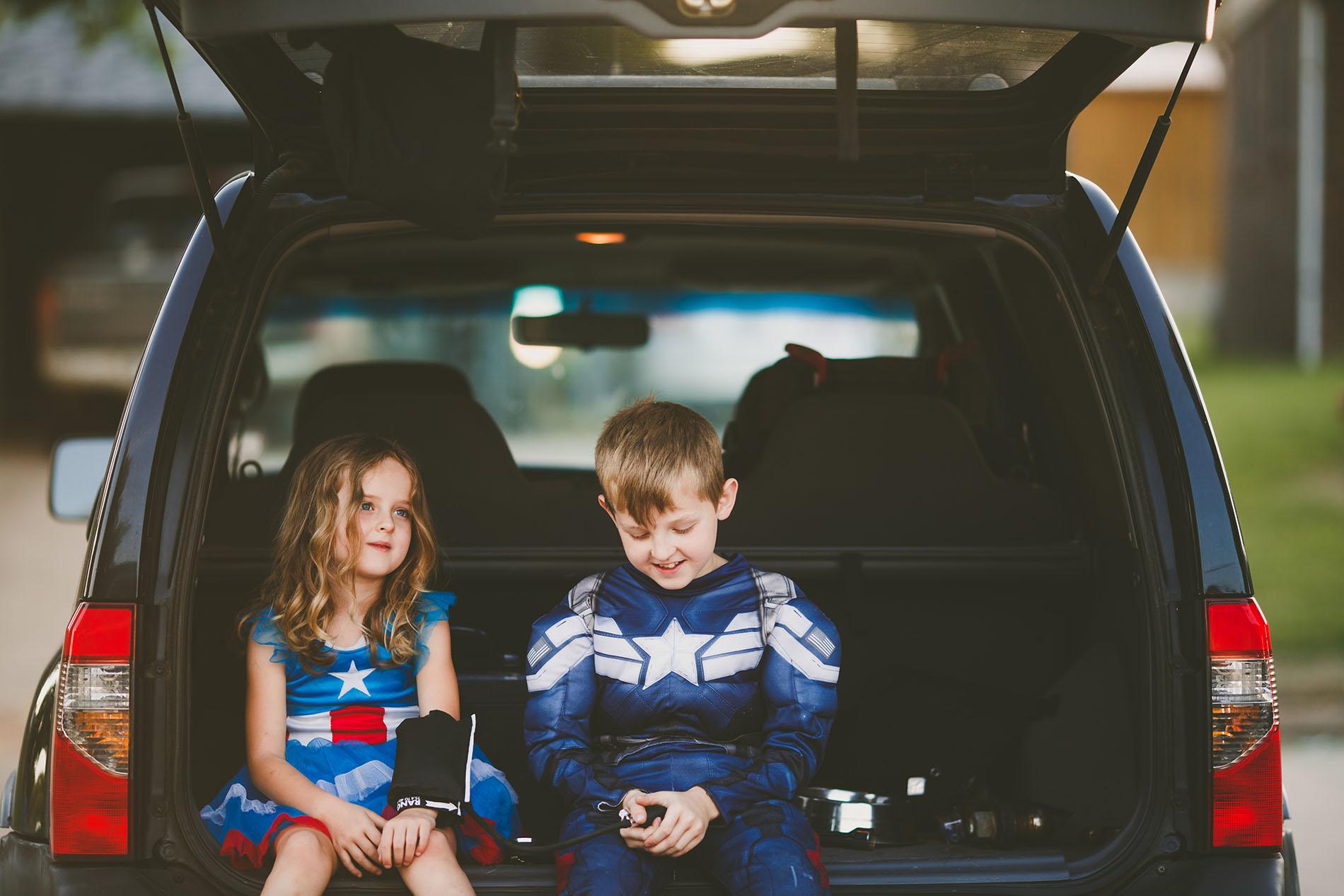 photo of two kids dressed like superheros by April Nienhuis