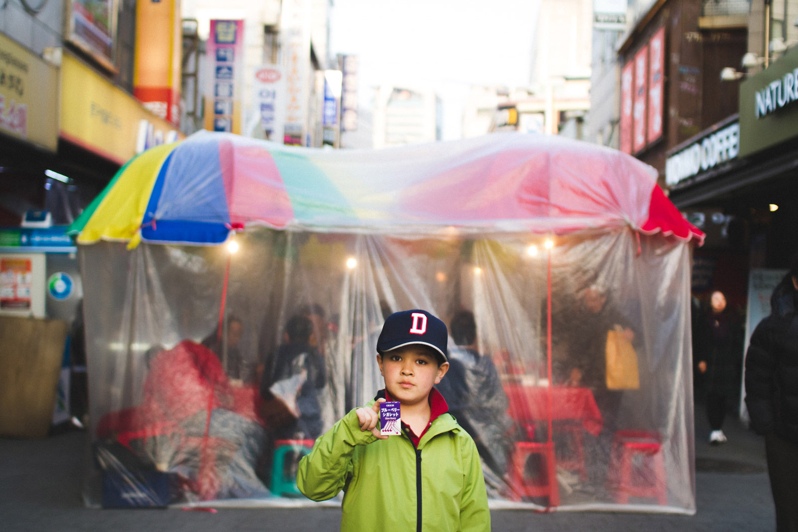 pic of boy in a hat holding candy by Jayne Cho