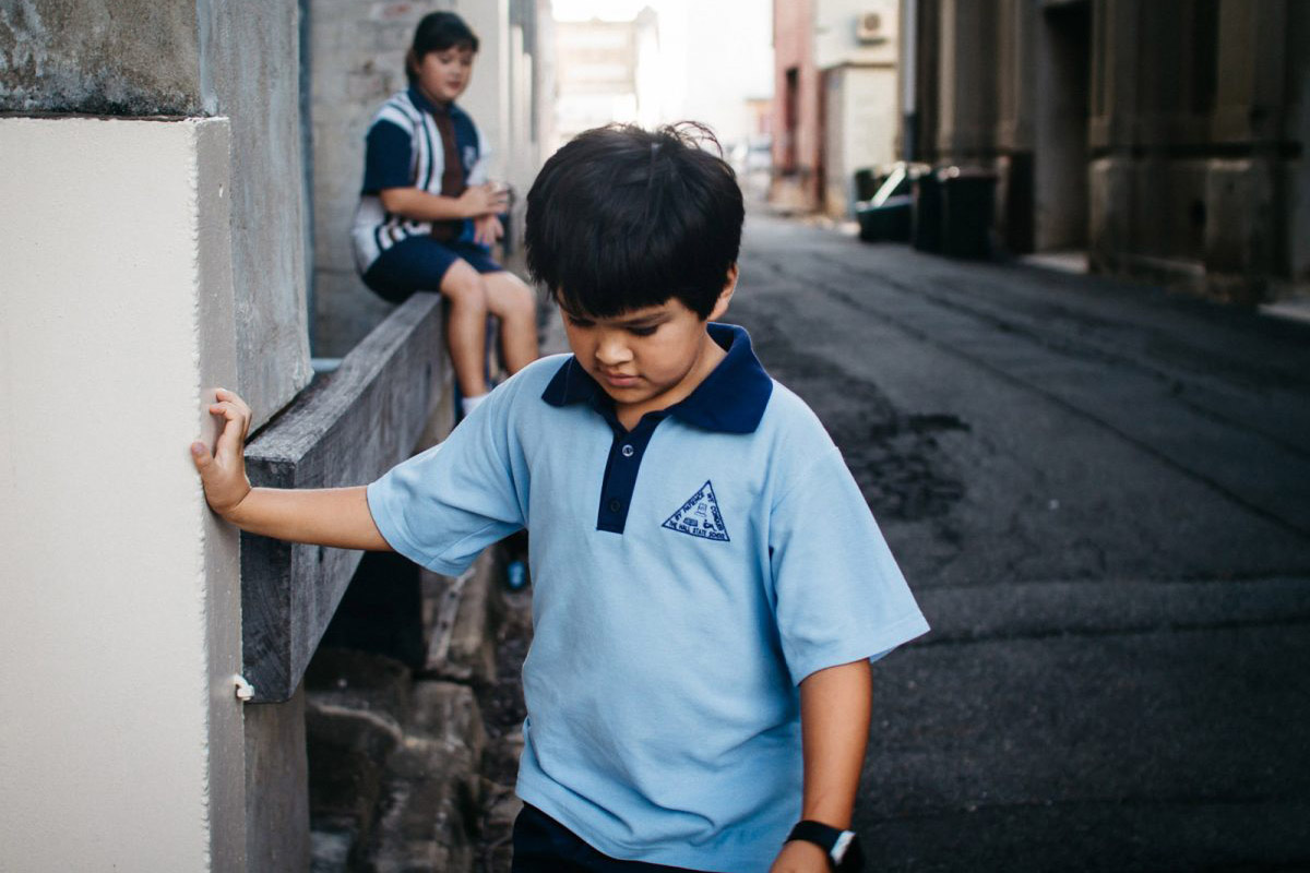 picture of kid walking down the street by Jayne Cho