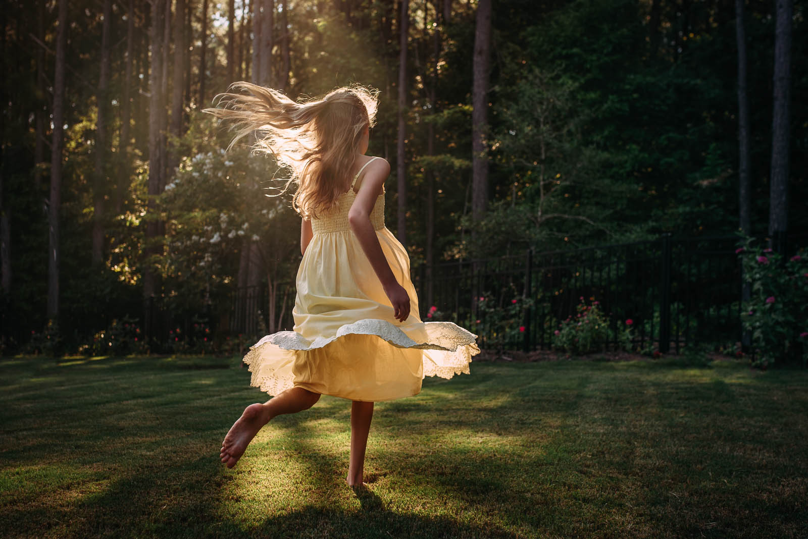 backlit photo of girl in a yellow sundress by Susan Grimes