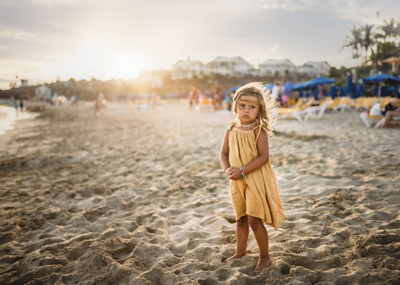 backlit pic of girl in a yellow dress on a beach by Anita Perminova