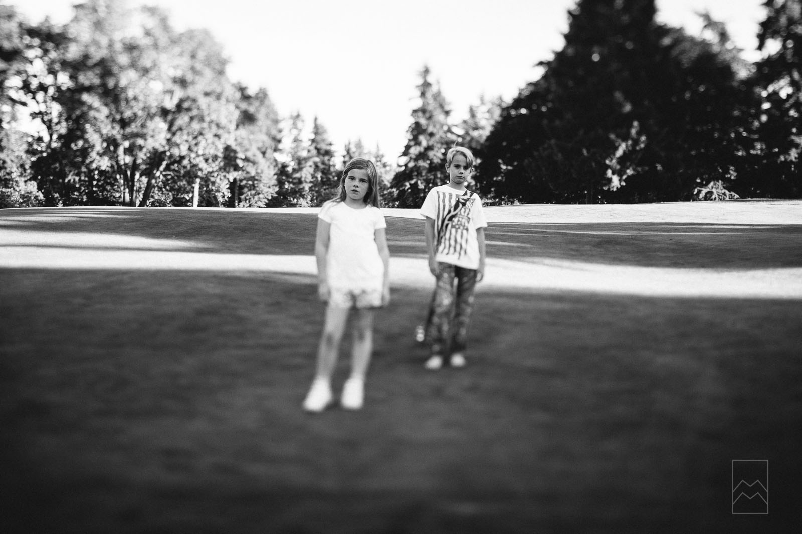 black-and-white-photo-of-two-kids-with-a-tilt-shift-lens-by-meghan-mcmackin
