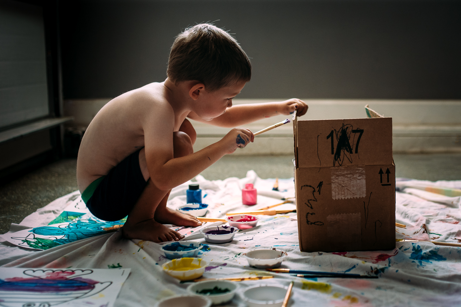 kid painting a box by Susan Grimes