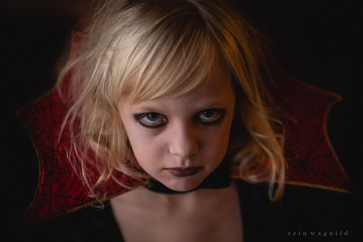 low light and spooky photo of girl ready for Halloween by Erin Wagnild