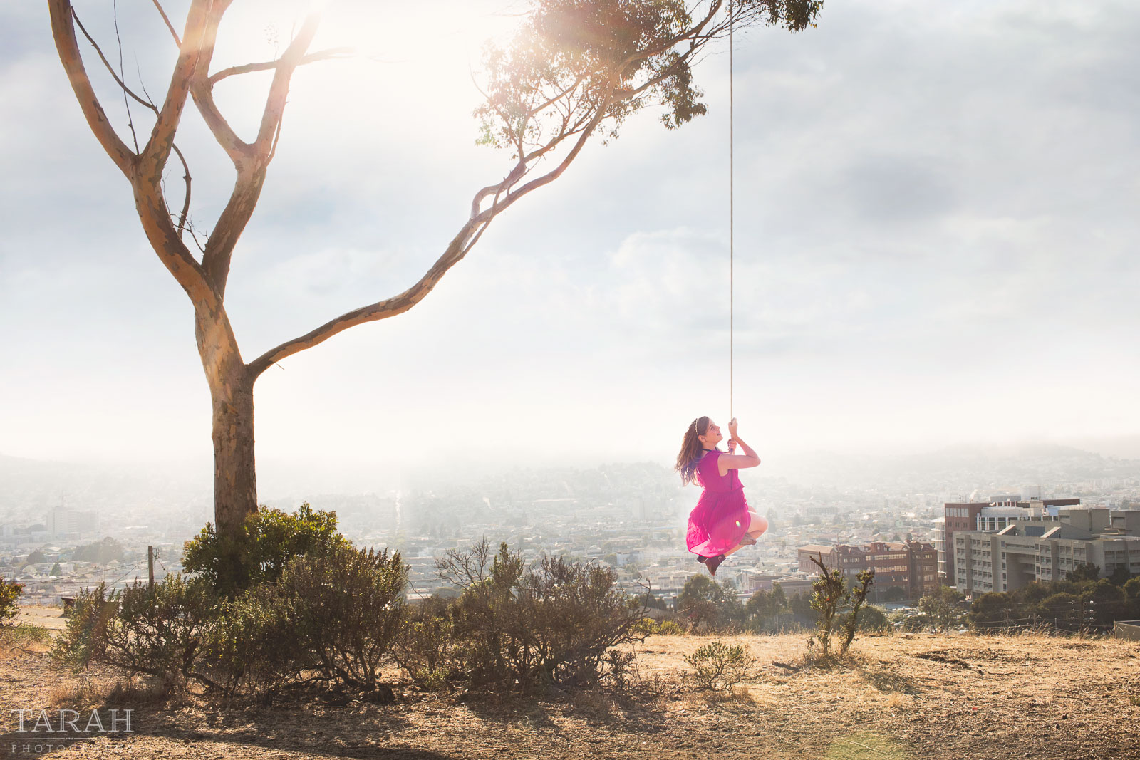 photo of girl on a swing overlooking San Francisco by Tarah Beaven