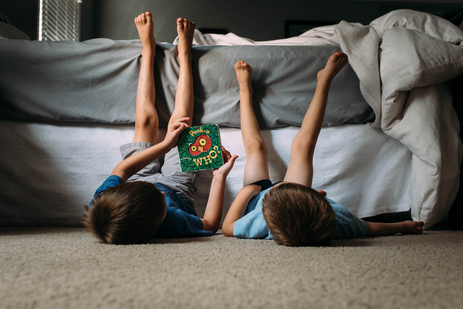 photo of two kids reading a board book by Susan Grimes
