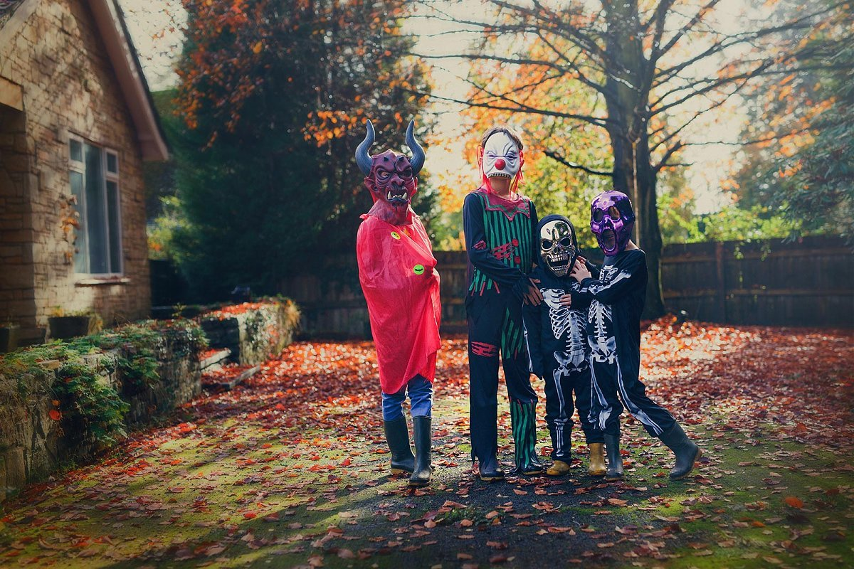 pic of kids with their Halloween masks on by Tamryn Jones