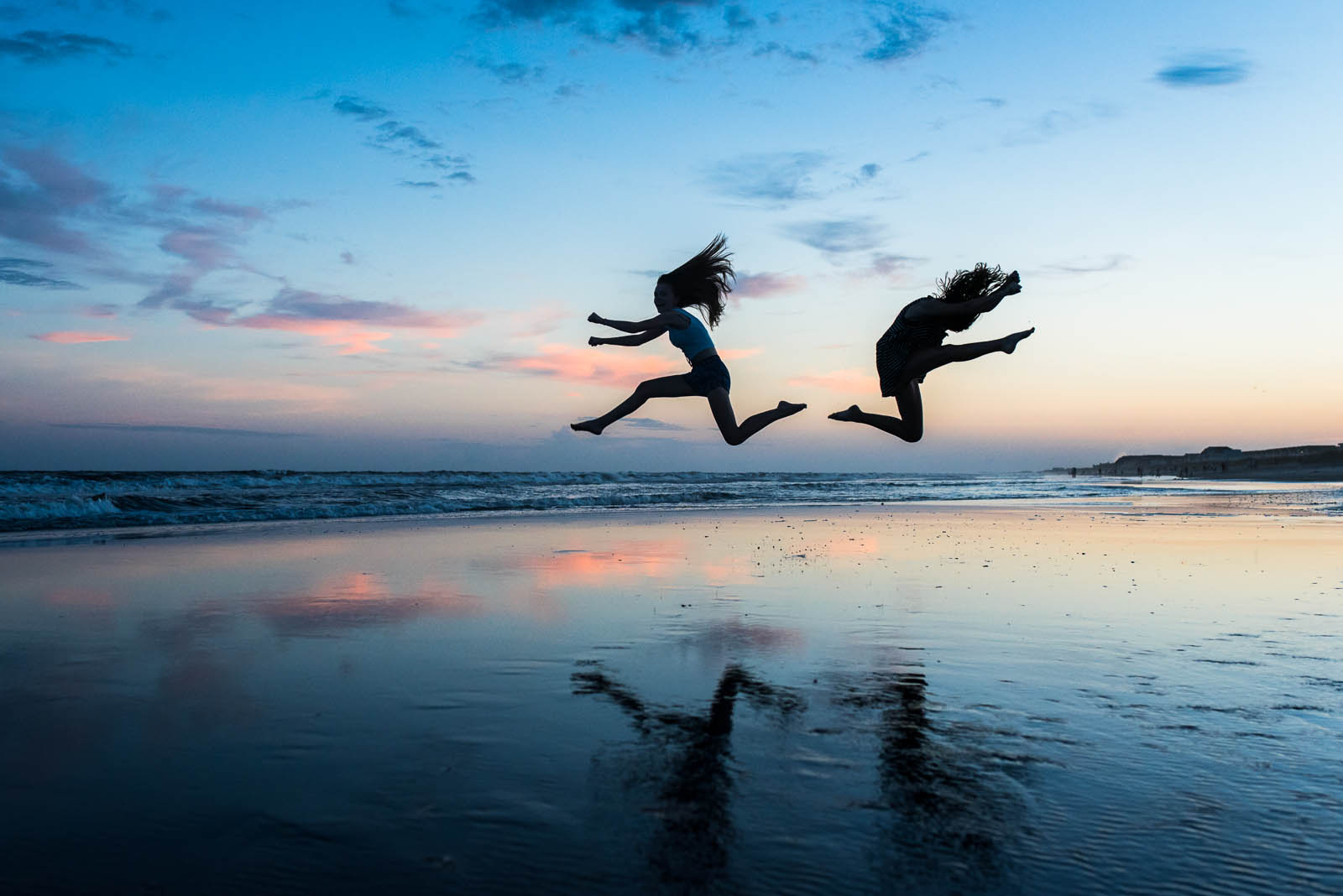 pic of two kids jumping on the beach by Susan Grimes