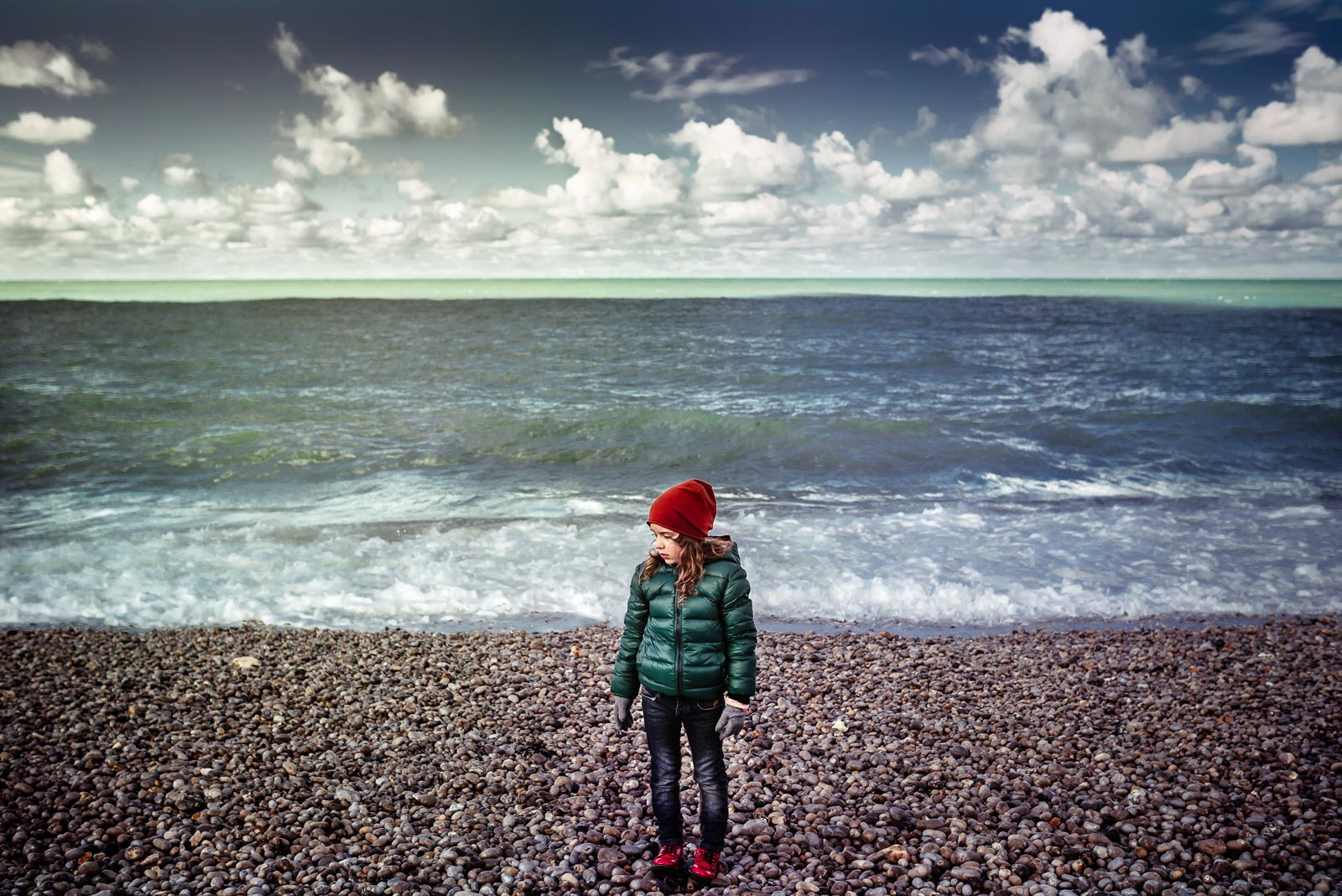 picture of girl on a rocky beach by Anita Perminova