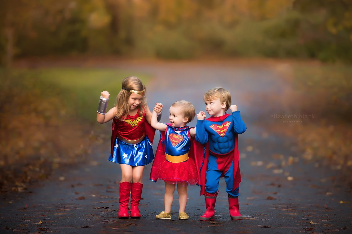 picture of three kids dressed up like superheros by Elizabeth Blank