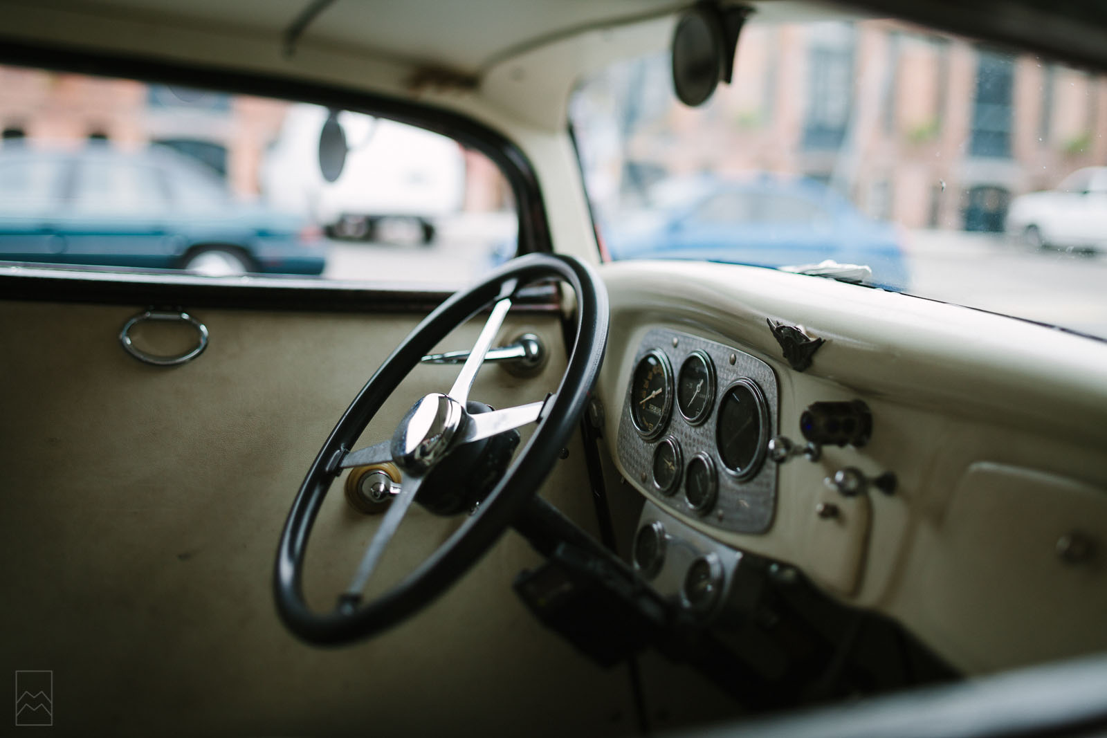 tilt-shift pic of vintage car steering wheel by Meghan McMackin