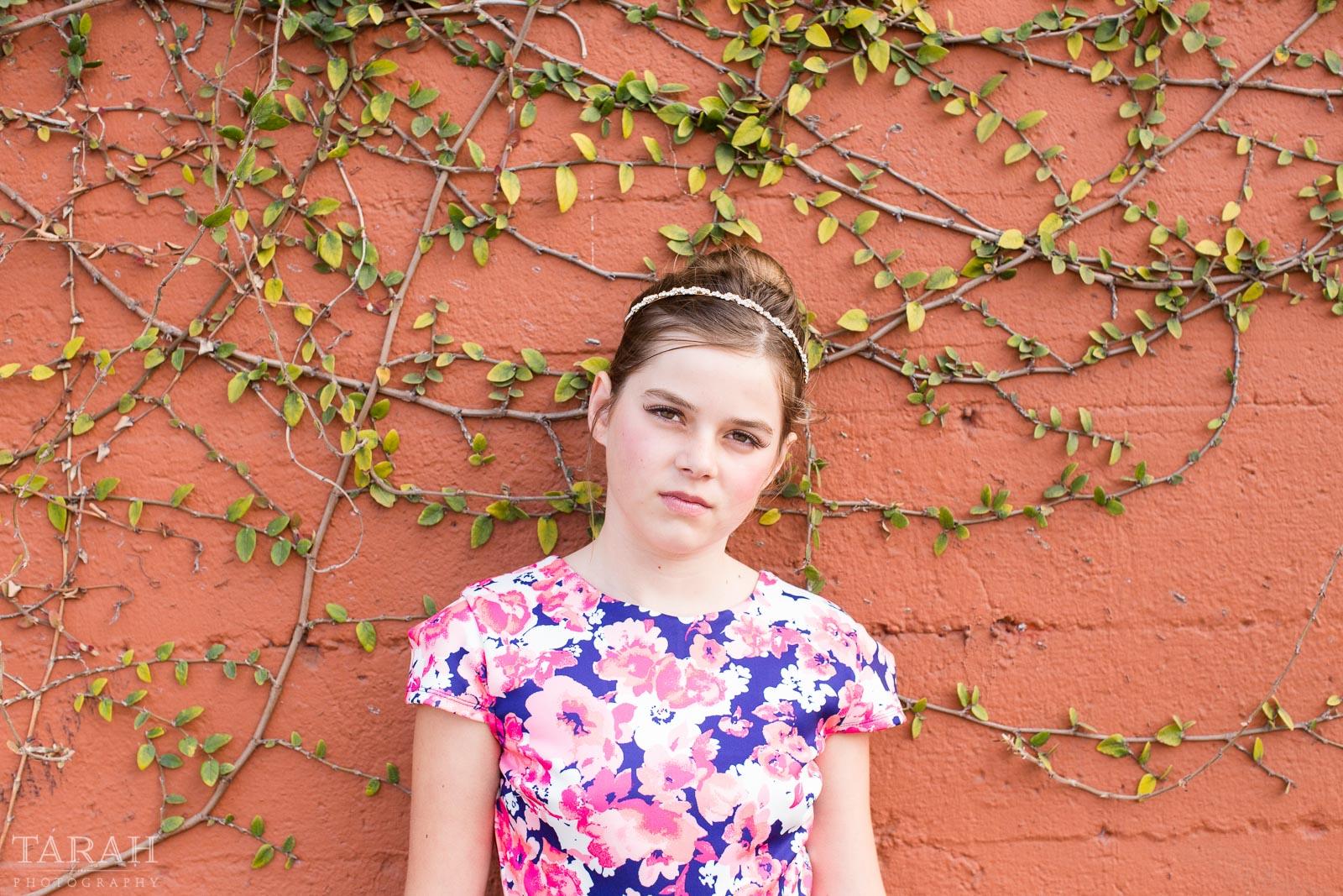 tween portrait against a wall by Tarah Beaven
