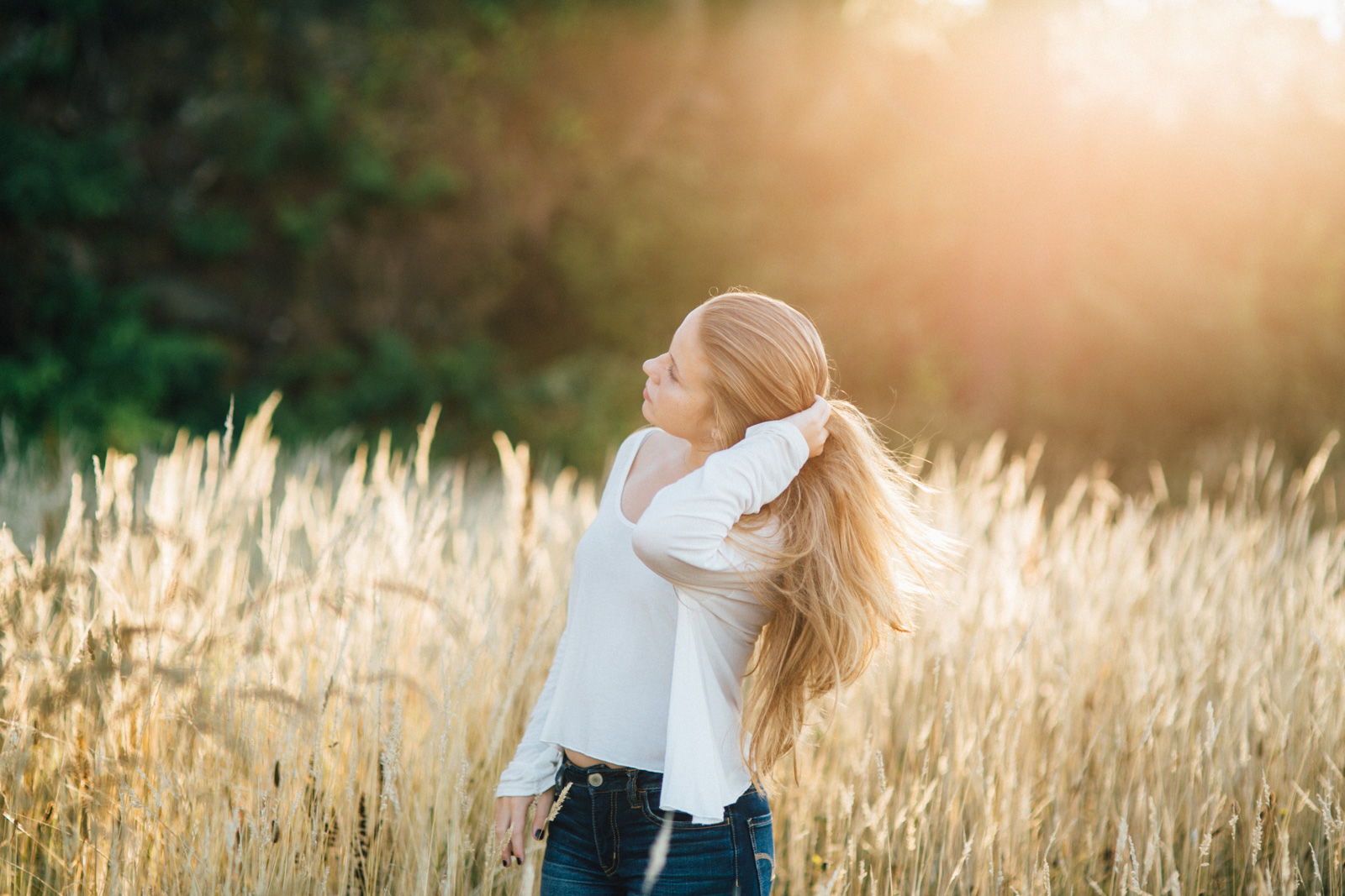 backlit photo of girl in a field by Cassandra Casley