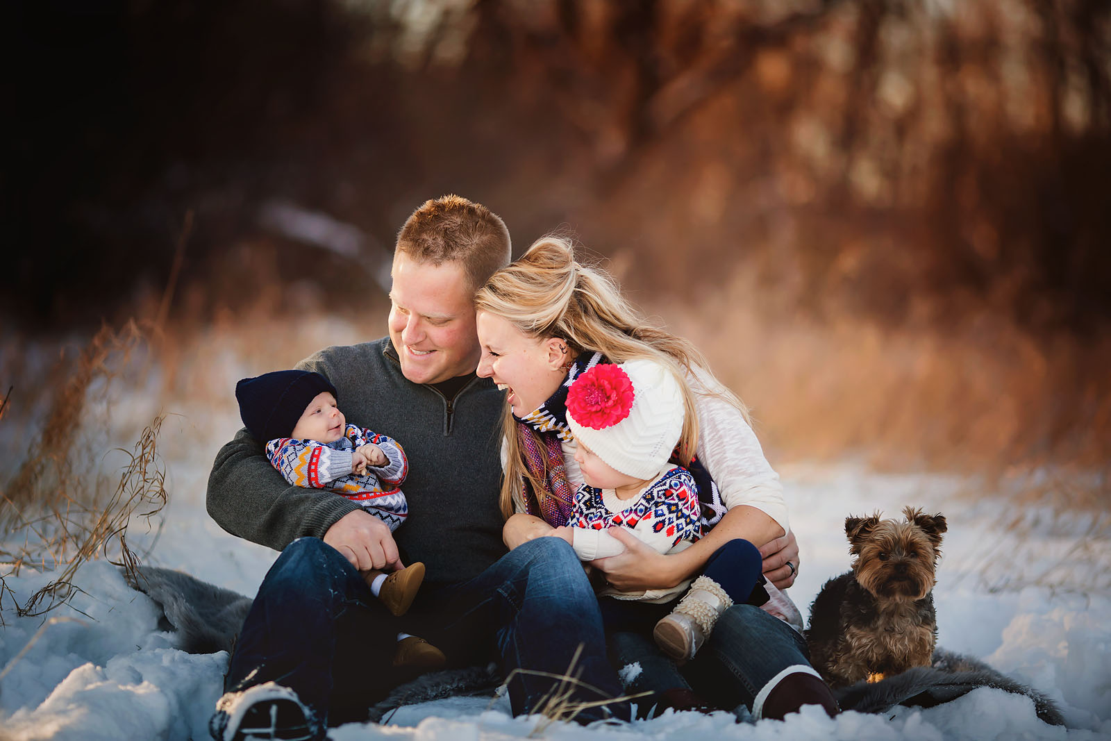family portrait with dog in the snow by Amber Walder