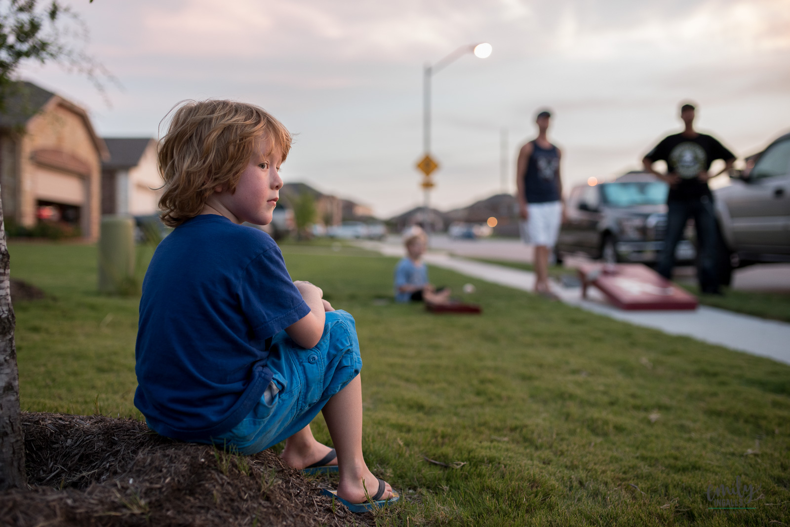 photo of boy sitting by himself by Emily Ingalls