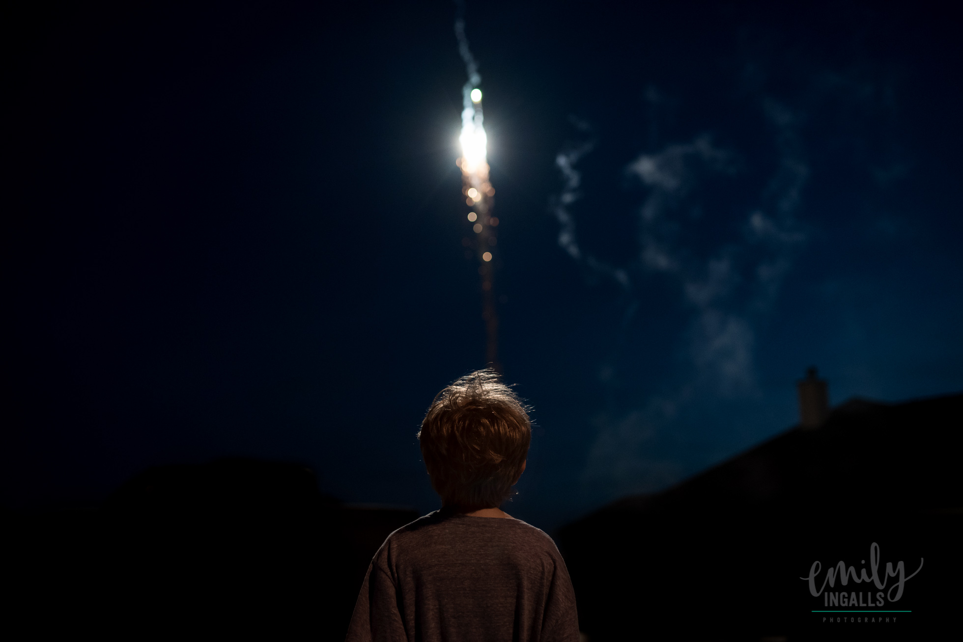 photo of boy watching fireworks by Emily Ingalls