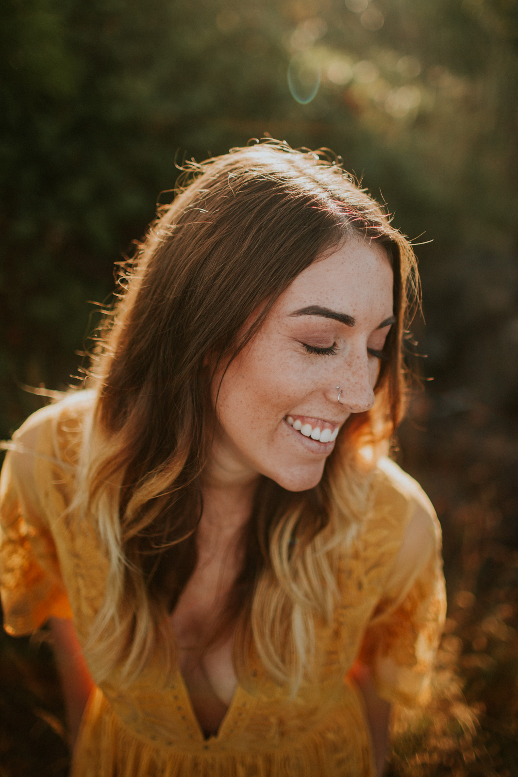 photo of woman with nose ring laughing by Cassandra Casley