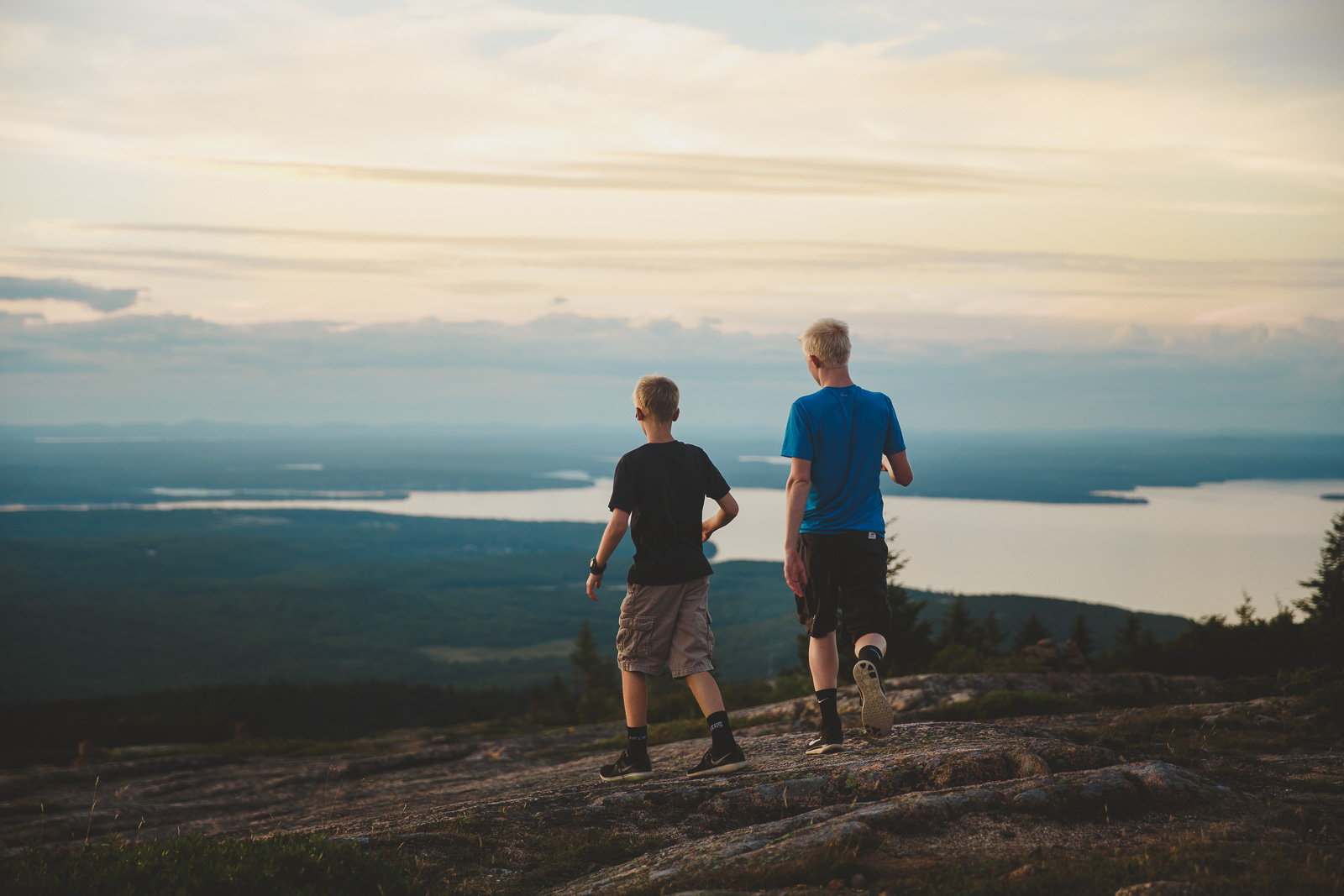 pic of brothers walking at sunset by Amy Nowak