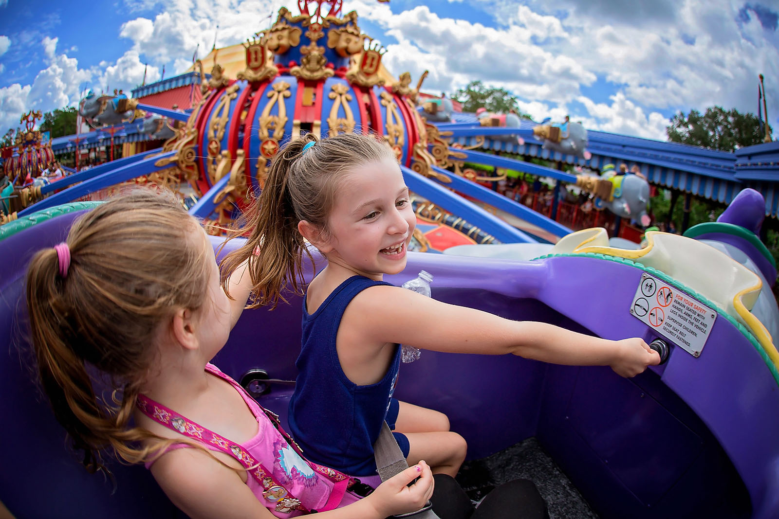 pic of girls riding dumbo at Disney World by Dana Nicole Photography