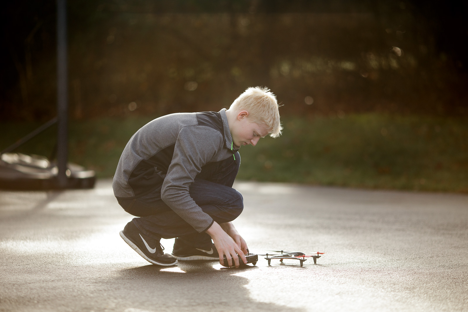 pic of teen with a remote control airplane by Amy Nowak