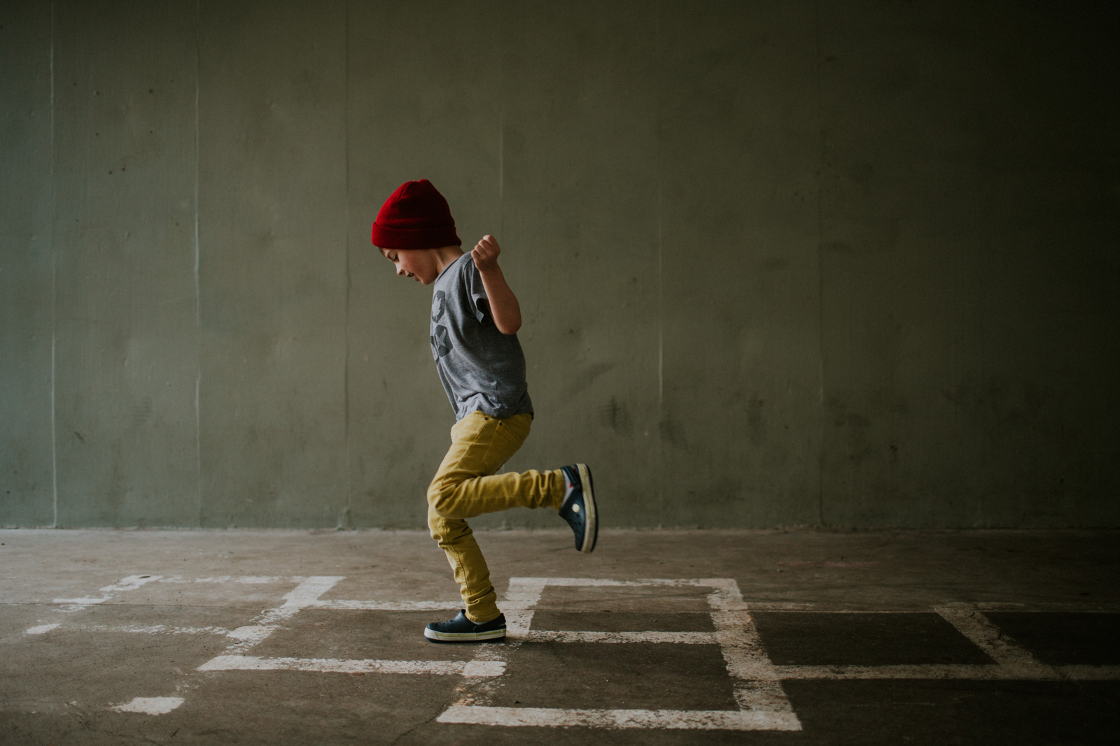 picture of boy playing hopscotch by Cassandra Casley