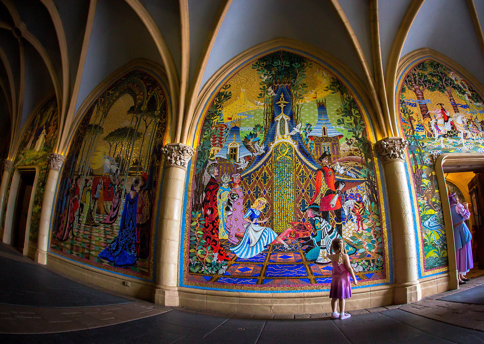picture of girl looking at Disney World Sleeping Beauty art by Dana Nicole Photography
