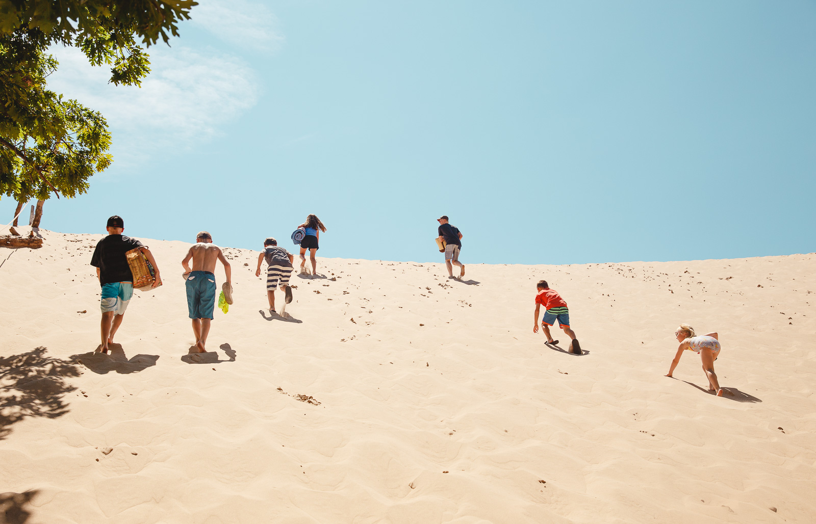 picture of kids running up a sand hill by Amy Nowak