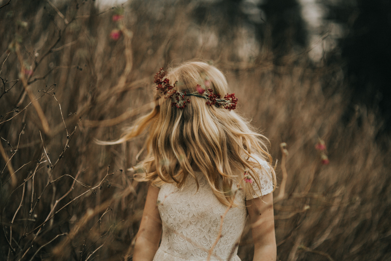 Picture Of Woman Wearing A Red Flower Crown By Cassandra Casley